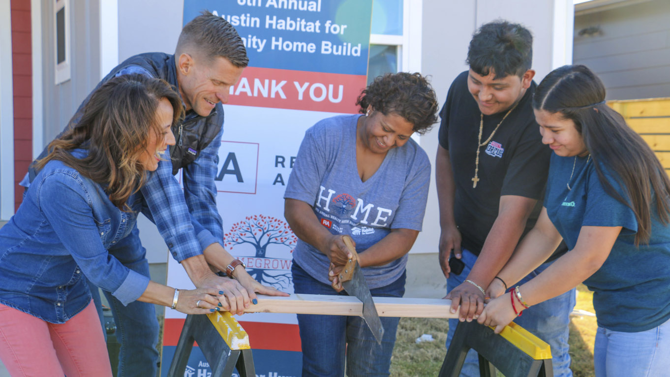 Realty Austin Dedicates Its 8th Austin Habitat For Humanity Home