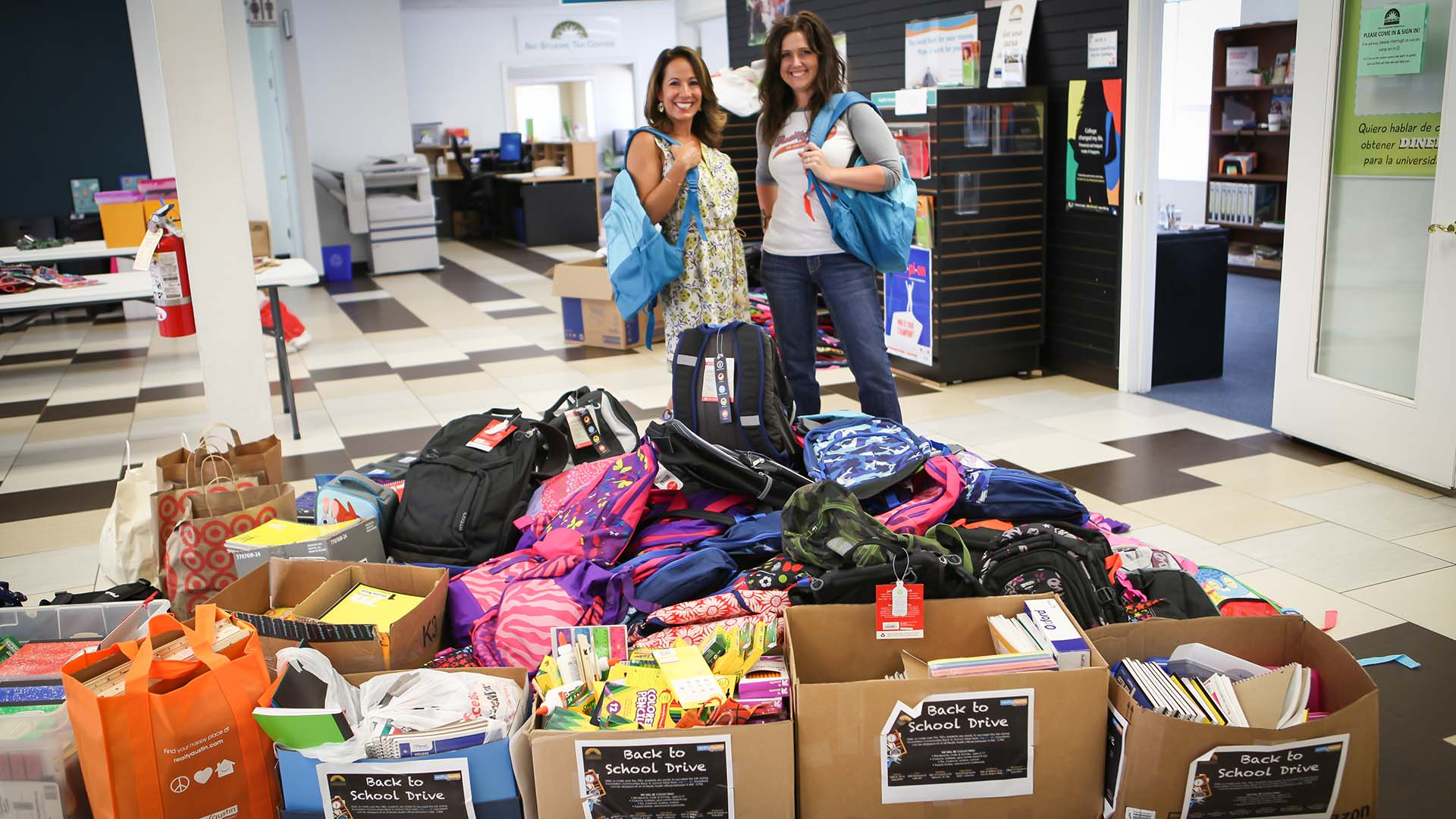 Image of Yvette Boatwright and Courtney Lepore with Realty Austin's donations